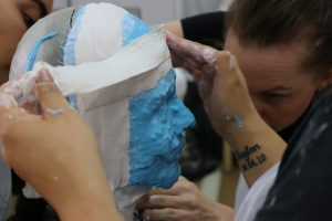 Image of person with plaster on face busy receiving a face cast - ACSM